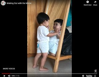 Viral Video: Kid Practices Self Love (Or At Least Adoration) With A Mirror